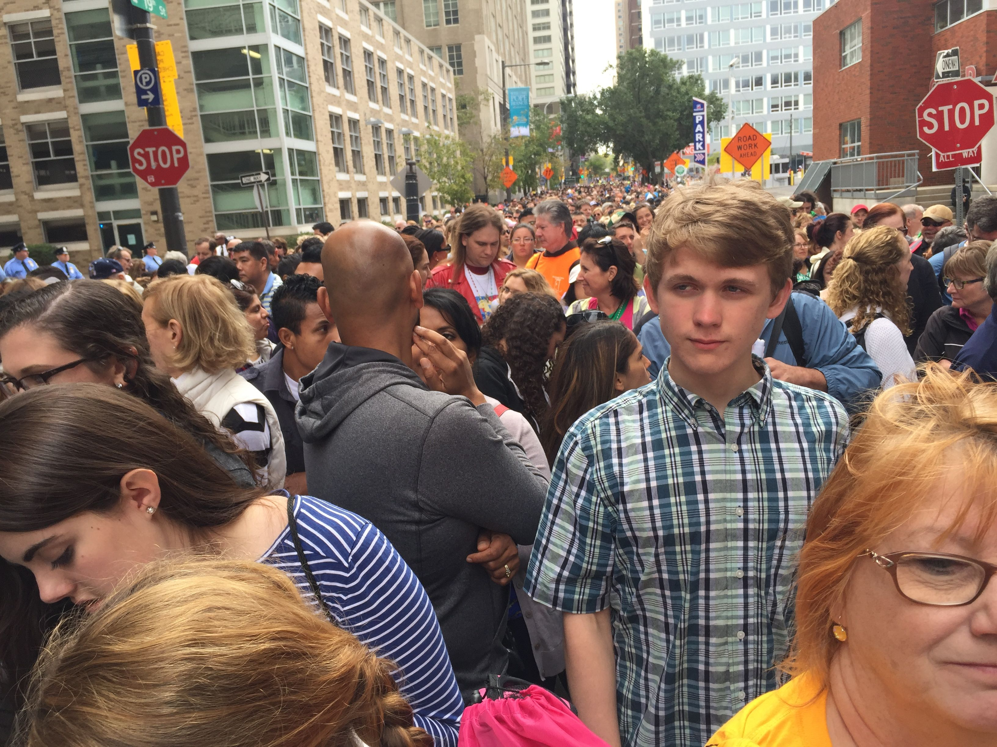 A view of the hundreds of people on line waiting to get in to the papal mass area in Philly.